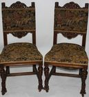 Pair of carved figural chairs