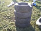 Lot# 719 - (4) MISC TIRES & FIVE LUG FOR
