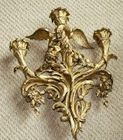 Pair of gilt sconces with bird