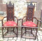 Unusual pair of carved armchairs