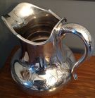 Sterling silver engraved pitcher