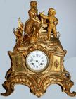 Gold bronze figural clock