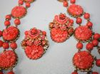 Close-up coral necklace and earrings