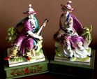 Porcelain figures on painted bases