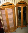 Pair of oak bowfront china cabinets