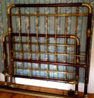 Unusual mahog and brass bed