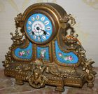 Enamel and porcelain figural clock