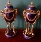 Pr. decorative cobalt vases with rams
