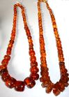 2 Large strands of amber beads