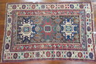 Lot 61) Antique Oriental Rug