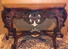Carved and decorated console table