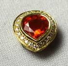 Lot 102: 18kt gold and orange sapphire