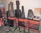CASES AND GUITAR MUSIC STANDS